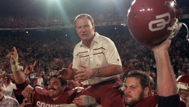 FILE - In this f Jan. 2, 1986 file phot, Oklahoma Sooners coach Barry Switzer gets a ride from jubilant players Tony Casillas, left, and an unidentified player, right, following their win over Penn State in the Orange Bowl college football game in Miami, Fla. Twenty years later, Switzer says he no longer dwells on his tearful resignation as Oklahoma's football coach. The school had been hit by NCAA probation and player arrests. The resignation led to the Sooners' decade-long exile from college football's elite.  (AP Photo/Mark Foley, File) ORG XMIT: OKSO102