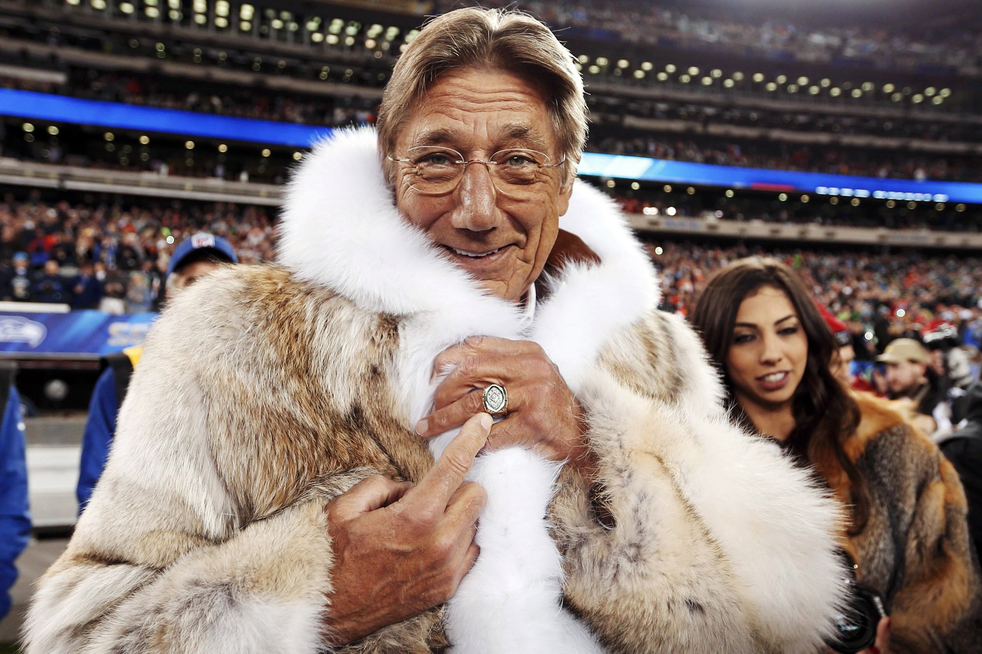 Former New York Jets quarterback Joe Namath points to his championship ring before the Seattle Seahawks play the Denver Broncos in the NFL Super Bowl XLVIII football game in East Rutherford, New Jersey, February 2, 2014. REUTERS/Carlo Allegri (UNITED STATES - Tags: SPORT FOOTBALL TPX IMAGES OF THE DAY)